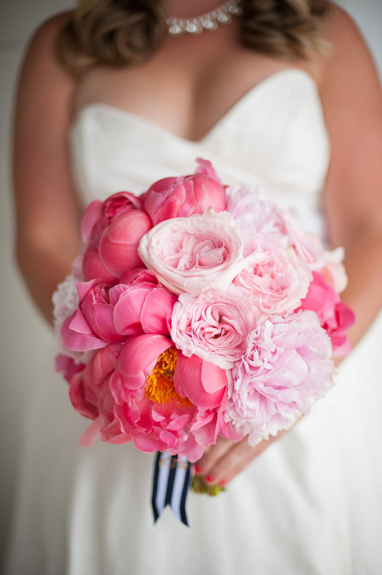 Lush bridal bouquet of fuchsia and pink peonies